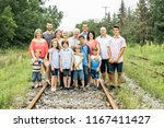 large family with cousin... | Shutterstock . vector #1167411427
