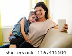 mother and daughter having... | Shutterstock . vector #1167415504
