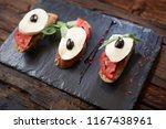 italian bruschetta with chopped ... | Shutterstock . vector #1167438961