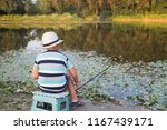 young fisherman on the lake... | Shutterstock . vector #1167439171
