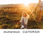father plays with his little... | Shutterstock . vector #1167439324