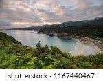 beautiful sunrise at beach ... | Shutterstock . vector #1167440467
