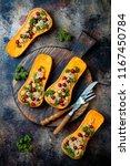 stuffed butternut squash with... | Shutterstock . vector #1167450784