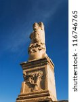 Small photo of Low angle view of a statue, Odeon of Agrippa, The Ancient Agora, Athens, Greece