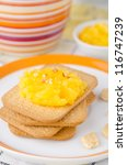 Biscuits with orange marmalade closeup - stock photo