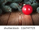 Red Christmas Ball On Wooden...