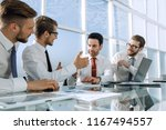 business team discusses... | Shutterstock . vector #1167494557