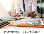 business documents on the desk... | Shutterstock . vector #1167530014