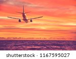 airplane flying over the sea... | Shutterstock . vector #1167595027