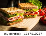 close up of two sandwiches with ... | Shutterstock . vector #1167610297