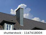 new tiled roof with chimney... | Shutterstock . vector #1167618004