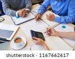 faceless shot of coworkers... | Shutterstock . vector #1167662617