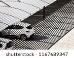 white clean cars on a parking... | Shutterstock . vector #1167689347