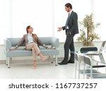 colleagues meet in the office... | Shutterstock . vector #1167737257