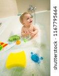 sweet little baby is bathing in ... | Shutterstock . vector #1167795664