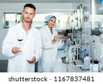 smiling man checking quality of ... | Shutterstock . vector #1167837481