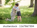army soldier embracing boy in... | Shutterstock . vector #1167867304
