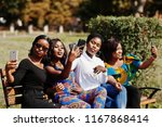 group of four african american... | Shutterstock . vector #1167868414