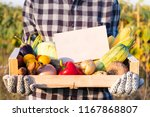 female farmer holding box full...