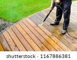 cleaning terrace with a power... | Shutterstock . vector #1167886381
