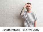 young adult man standing over... | Shutterstock . vector #1167919087