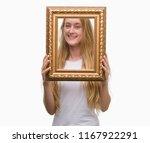 blonde teenager woman holding... | Shutterstock . vector #1167922291