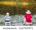 two little boys fishing on the... | Shutterstock . vector #1167929971