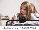 school children in classroom at ... | Shutterstock . vector #1168026994