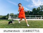 happy pretty woman in park... | Shutterstock . vector #1168027711