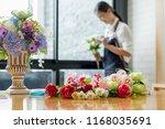 woman hands making flower... | Shutterstock . vector #1168035691