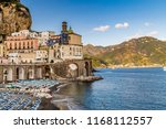 resorts and sunshades on the... | Shutterstock . vector #1168112557