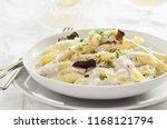 penne alla norcina   italian ... | Shutterstock . vector #1168121794