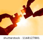 two hands trying to connect... | Shutterstock . vector #1168127881