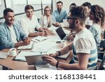 young smiling business people... | Shutterstock . vector #1168138441