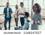 group of young business people... | Shutterstock . vector #1168147027