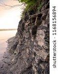 rocky coast. a stony cliff. a... | Shutterstock . vector #1168156894