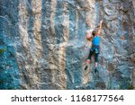 the girl climbs the rock. the... | Shutterstock . vector #1168177564