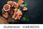 oatmeal porridge with figs ... | Shutterstock . vector #1168182241