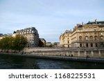 """Small photo of Paris, France. Autumn embankment of the river Seine (Quai des Orfevres). View on the Ile de la Cite """"Island of Paris"""""""