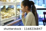 profile shot of an adorable... | Shutterstock . vector #1168236847