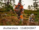 hunter and hunting dogs chasing ... | Shutterstock . vector #1168242847
