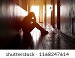 desperate man in silhouette... | Shutterstock . vector #1168247614