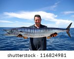 Lucky  Fisherman Holding A...