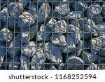 stone gabion with grey stones | Shutterstock . vector #1168252594