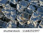 stone gabion with grey stones | Shutterstock . vector #1168252597