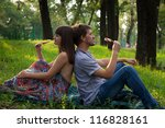 Young Couple Eating Ice Cream...