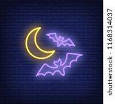 flying bats neon sign. luminous ... | Shutterstock .eps vector #1168314037