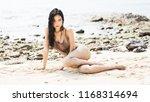 beautiful young woman in bikini ...   Shutterstock . vector #1168314694