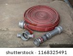 fire fighter hose ready to use... | Shutterstock . vector #1168325491