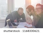 group of young architects in a... | Shutterstock . vector #1168330621